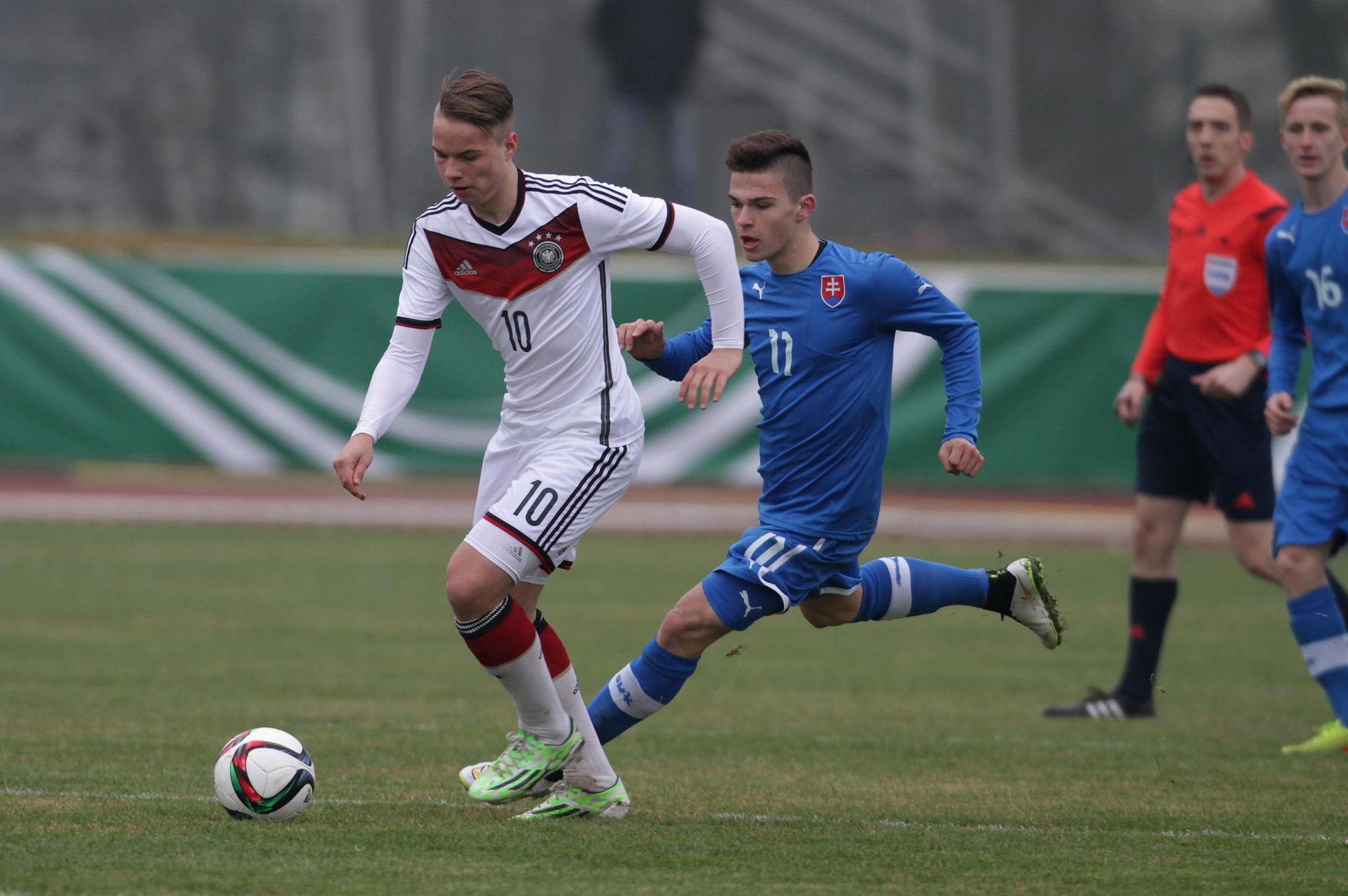 WETZLAR, GERMANY - MARCH 21:  Niklas Schmidt (Germany, L) tackles Lubomir Tupta during the UEFA U17 elite round match between Germany and Slovakia on March 21, 2015 in Wetzlar, Germany.  (Photo by Juergen Schwarz/Bongarts/Getty Images)